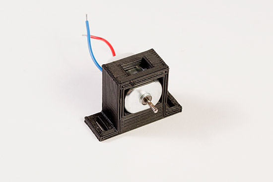 Motor in third holder